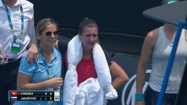 Jakupovic, pictured being escorted from the court yesterday, said the toxic smoke made her unable to go on competing