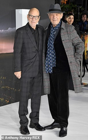 Dapper: The Lord of the Rings star looked sharp in a gray plaid coat, which he wore over a completely black outfit and combined with a blue patterned scarf and a gray bowler hat
