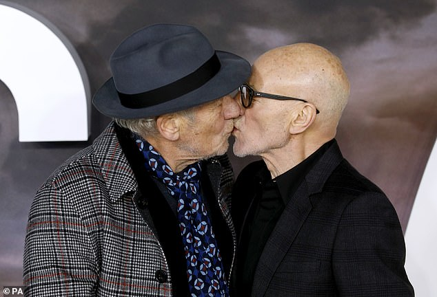 Smooch: the couple leaned in to kiss while they posed to take pictures together