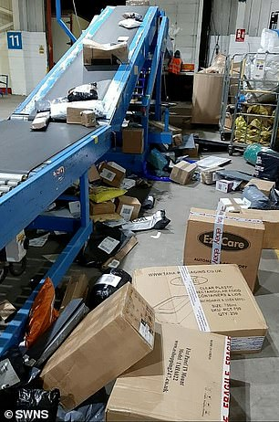 Among the countless items one worker has seen tossed carelessly in the last month were Christmas trees, decorations and gifts. Pictured: A conveyor belt