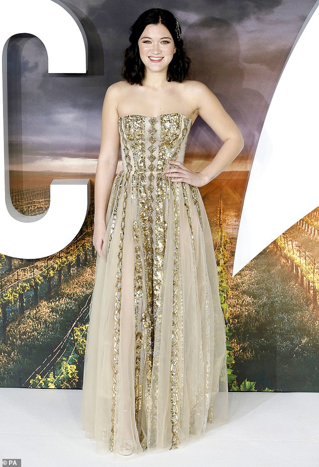 Beautiful: Isa Briones, who plays the new character Dahj, dazzled in a semi-transparent white dress that was adorned with golden details.