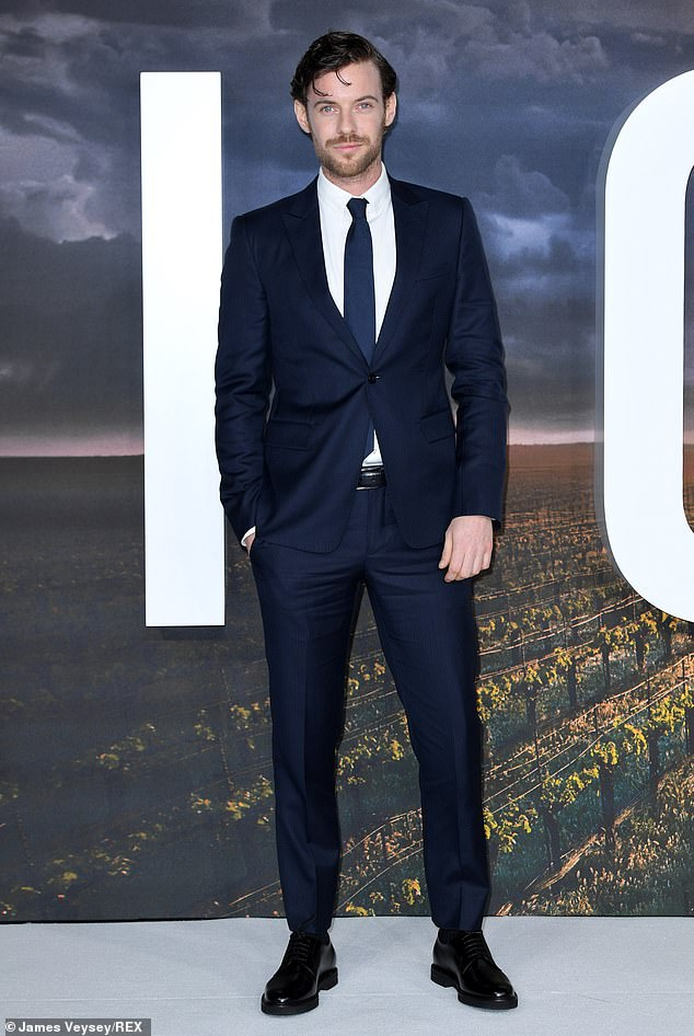 Proper and kicked: Harry Treadaway, who plays Narek on the show, kept things simple by going out in a blue suit and tie