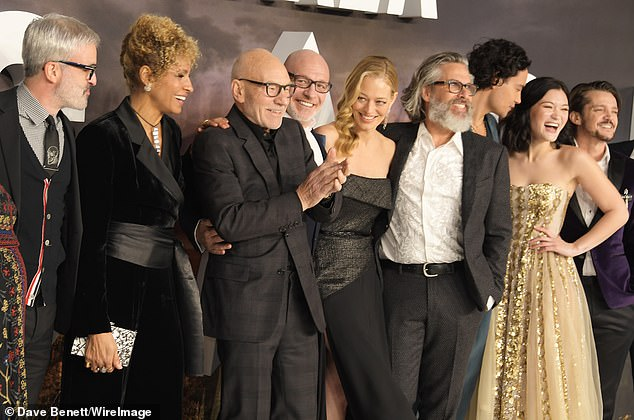 Excited: Sir Patrick seemed ecstatic while standing next to his castmates.