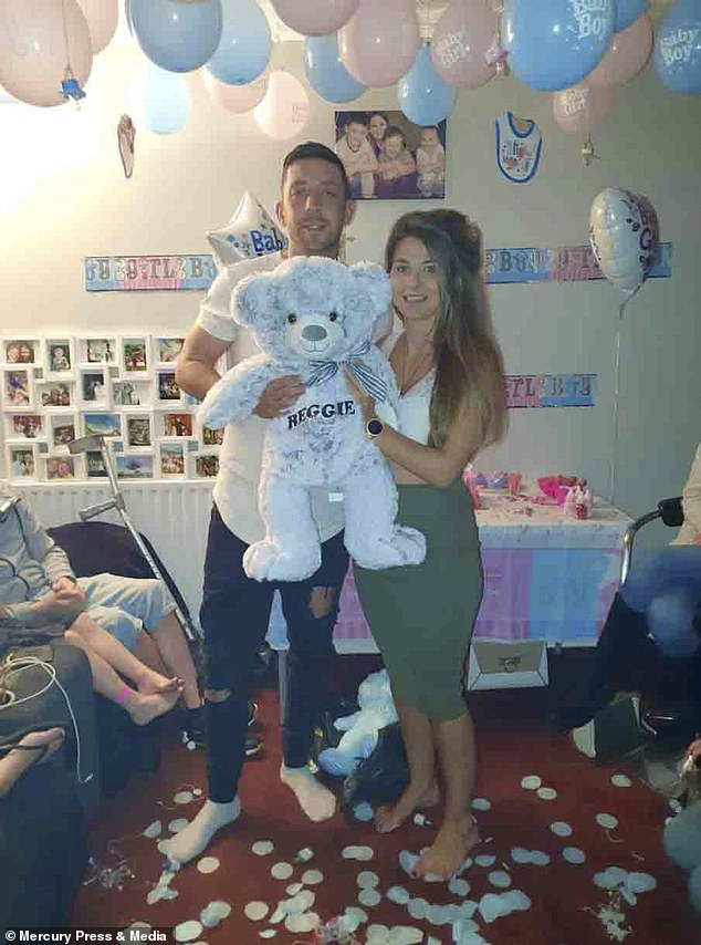 Women with a septate uterus are at increased risk of miscarriage. Ms Guinness tried desperately to have a baby despite knowing her anatomy was unusual. Pictured, the couple after having a gender reveal party and finding out they were having a boy