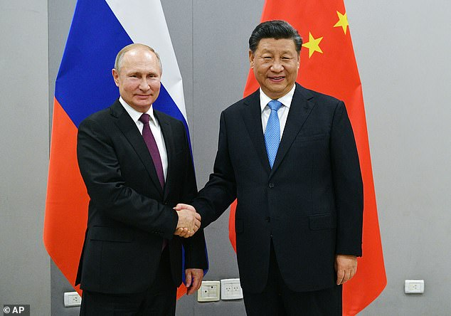 China's Xi Jinping (pictured right) with Russia's Vladimir Putin amended his nation's constitution to remove presidential term limits - which has effectively made him ruler-for-life