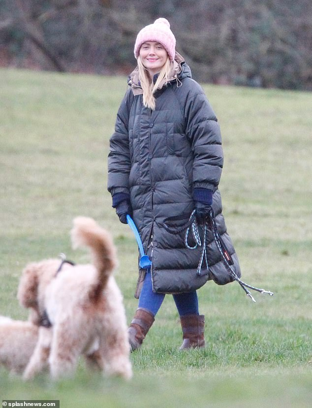 Moving on: Anne-Marie Corbett grinned as she was seen for the first time since it was reported Ant McPartlin will give Lisa Armstrong £31 million in divorce settlement