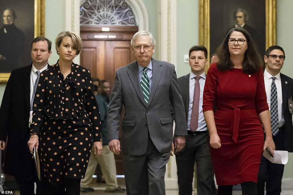 Senate Majority Leader Mitch McConnell walks to the Senate floor Thursday, as the House impeachment managers are due in his chamber in several hours