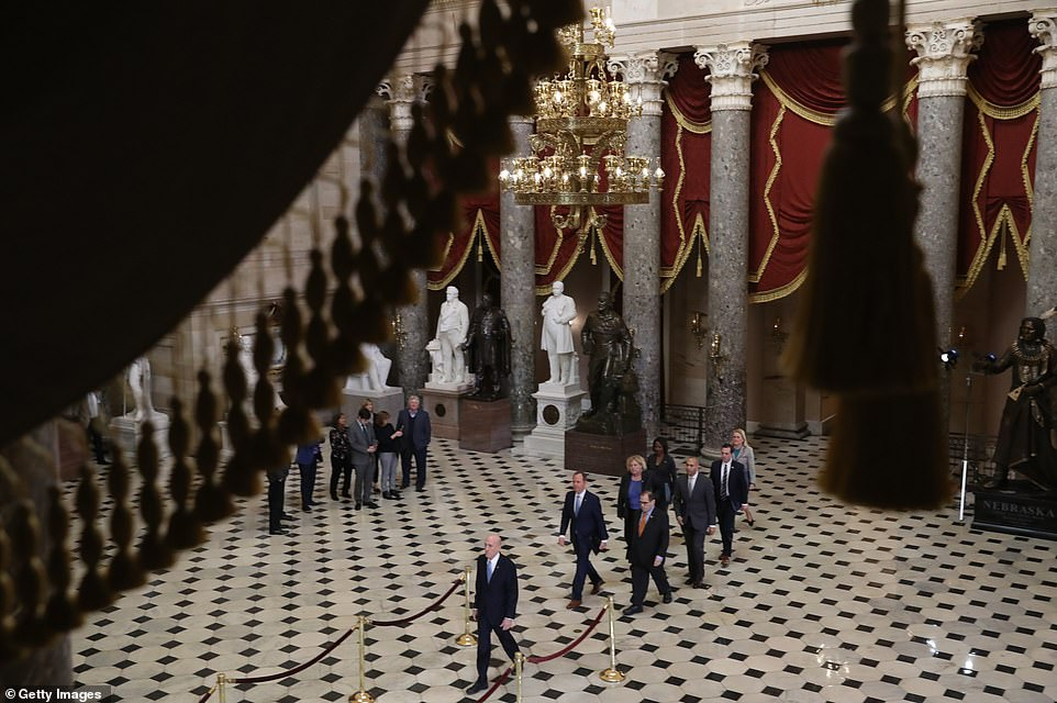 Setting: House Sergeant-at-arms Paul Irving leads the seven Democratic impeachment managers through Statuary Hall, from the House to the Senate