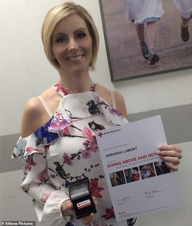 Dr Lamont, pictured with her award, received recognition for 'going above and beyond the call of duty' following the disaster
