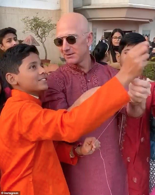 Bezos on Thursday posted video on his Instagram account showing him flying a kite alongside Indian youths