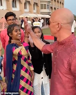 Bezos high-fives a young Indian girl in the video, which was apparently filmed in Delhi