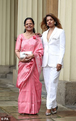M.I.A, with her mother, accepted an MBE medal from Prince William for services to music this week
