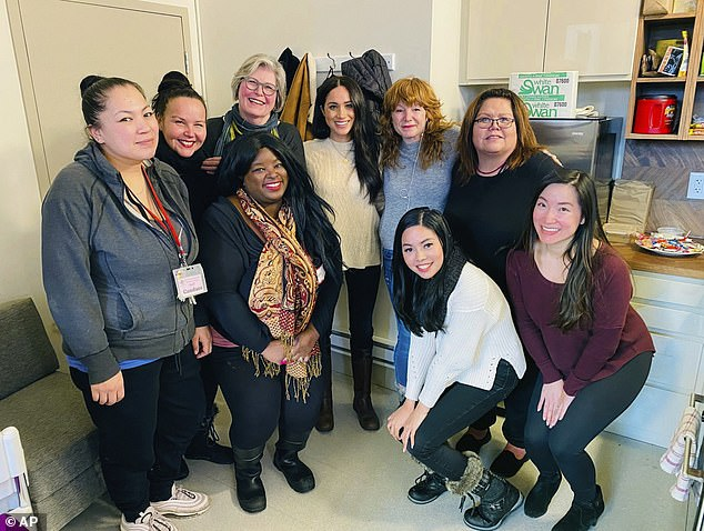 On Tuesday, Meghan was seen for the first time since the bombshell news that she was quitting the Royal Family. She broke cover leaving the $14 million mansion where she has been holed up since last week to visit a women's shelter in Canada's poorest neighborhood. Meghan pictured with staffers from Downtown Eastside Women's Centre