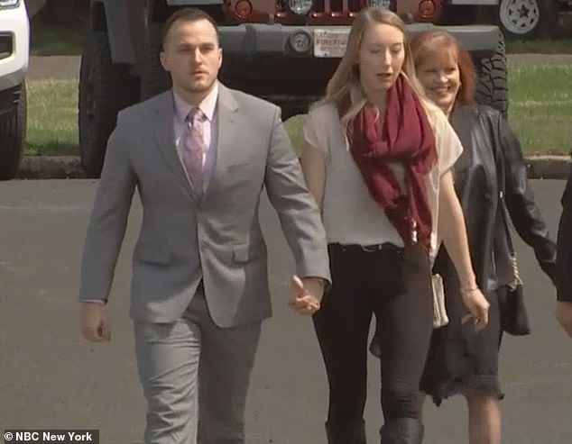 Aimers was supported publicly by his wife, Kayla, who was seen holding her husband's hand as they made their way into court for proceeding last April