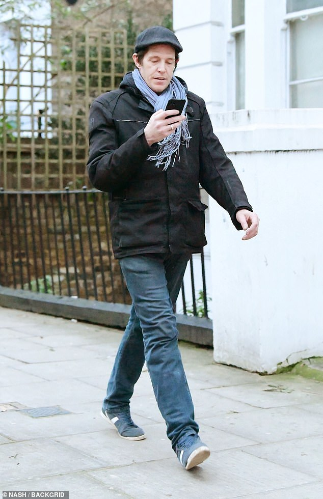 Out and about:Pierce Brosnan's estranged son Christopher, 47, cut a casual figure as he stepped out in London on Friday