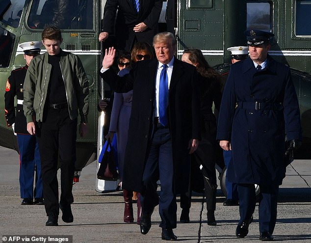 Entourage: The Trump family was seen walking across the tarmac at Joint Base Andrews