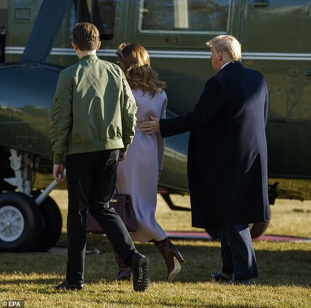 Gesture: Trump rested his hand on Melania's back right before she stepped on Marine One