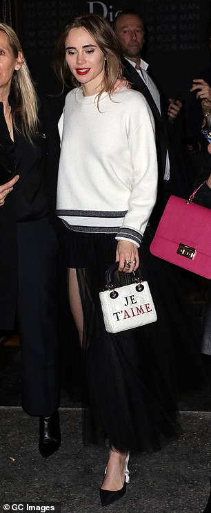 Fun: She teamed the top with a dramatic black tulle skirt as she headed out of the bash
