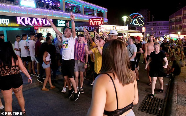Regional government spokesman said the rule was brought in to tackle a 'specific problem in a specific area'. (Magaluf revellers in 2018)