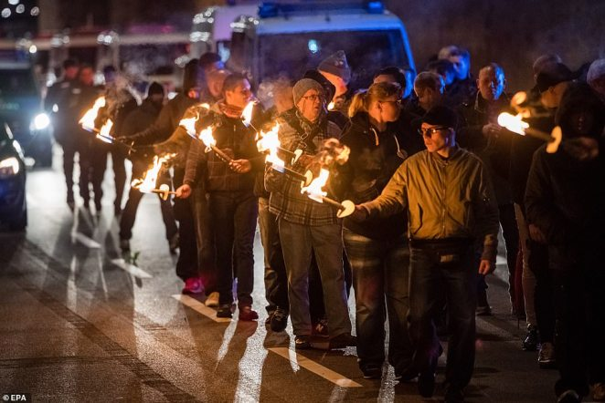 Far right protesters lit torches as they marched through the streets of Magdeburg, in Germany, to commemorate the RAF raid