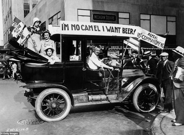 Prohibition protesters parade in a car emblazoned with signs and flags calling for the repeal of the 18th Amendment. The repeal movement began to gain momentum with the Association Against the Prohibition Amendment that was backed by John D Rockefeller, Jr and the Du Pont family. Repeal supporters argued that legalizing the sale of alcohol would create jobs, bring in tax revenue and weaken organized crime.