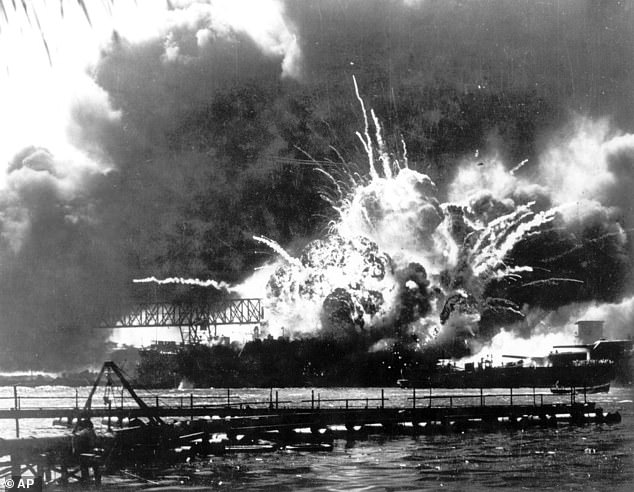 The destroyer USS Shaw explodes after being hit by bombs during the Japanese attack on December 7 1941
