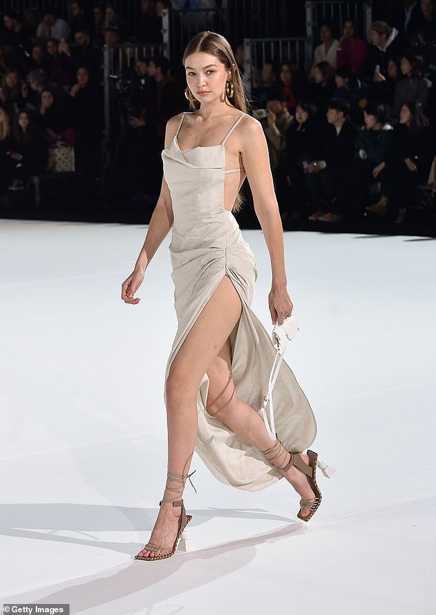 Work it:Meanwhile, Gigi also put on a showstopping display as she rocked a similar dress to her younger sister
