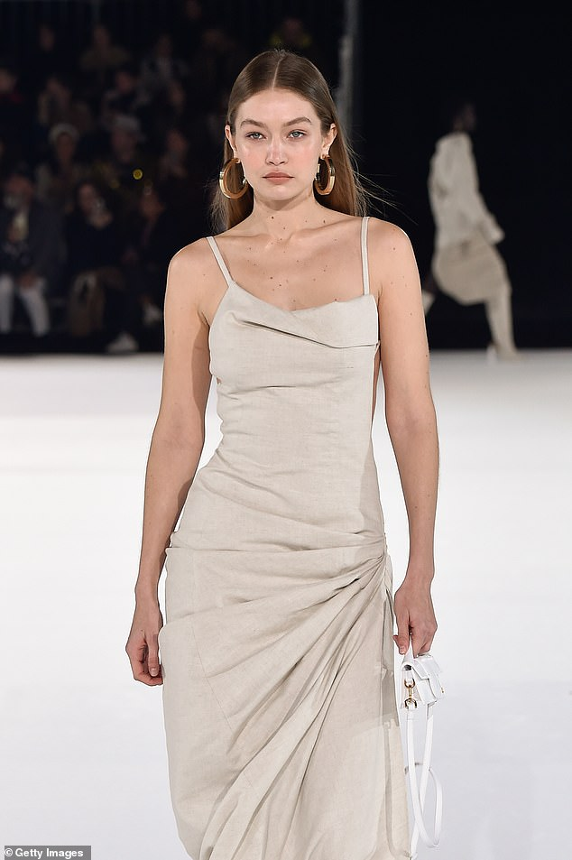 Runway look:Gigi, who recently reunited with on-off beau Zayn Malik, added a pair of camel sandals and gold hooped earrings