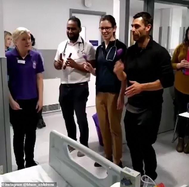 Having fun: In a video posted by the hospital, the star is seen jumping back and forth in a dance routine along with the Singing Doctors Medicine Team