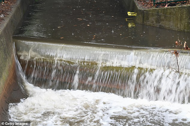 Rain is expected to continue lashing parts of drought-stricken NSW. Pictured: A stormwater drain overflows in North Sydney for the first time in months