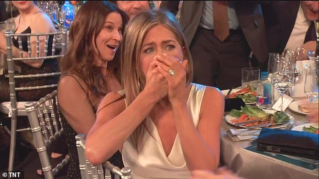 'Whaat?!': The blonde bombshell clapped her hands to her mouth at her table when her victory was announced against such names as Olivia Colman and Helena Bonham Carter