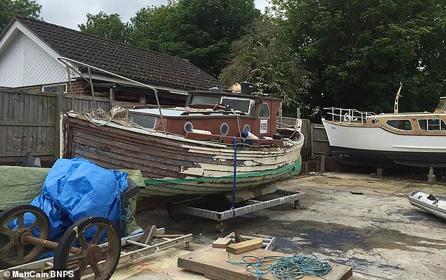 It had been languishing in a rotting, dilapidated state in an Essex boatyard (pictured) when IT manager Matt Cain paid £3,000 for it in 2009 after spotting it for sale online