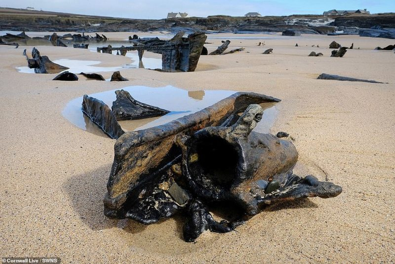 There are large parts of the metal hull visible on the beach after being exposed by storms before Christmas