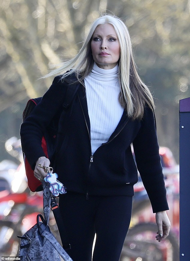 Caprice on ice: She completed her look with a pair of black leggings and a pair of matching trainers
