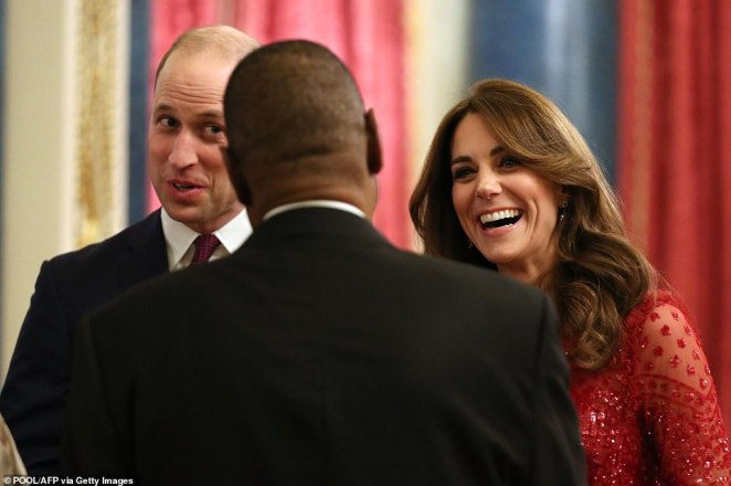 Prince William and Kate Middleton chat to a guest at the reception this evening.The day-long summit was held to highlight the strength of the relationship between the UK and African nations