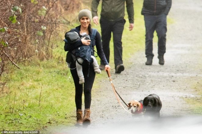 She wrapped up in layers under a fawn beanie hat, wearing black leggings and her favorite Kamick ankle-high brown hiking boots