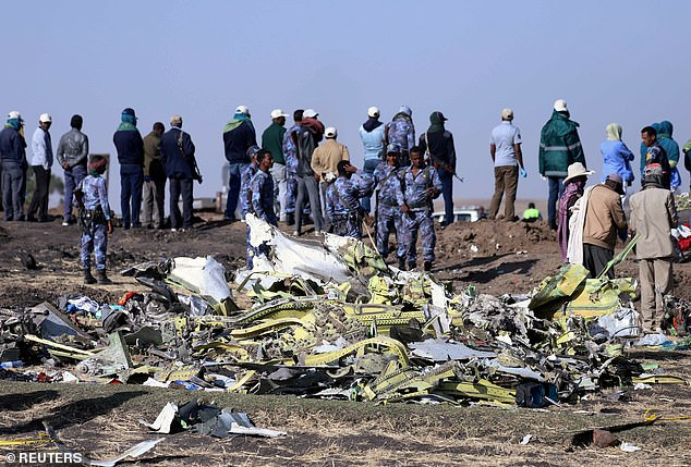 Ethiopian Federal policemen stand at the scene of the Ethiopian Airlines Flight ET 302 plane crash, near the town of Bishoftu, southeast of Addis Ababa, on March 11, 2019