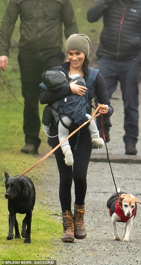 She smiled strolling through Horth Hill Regional Park holding her two dogs, black lab Oz and beagle Guy on leashes