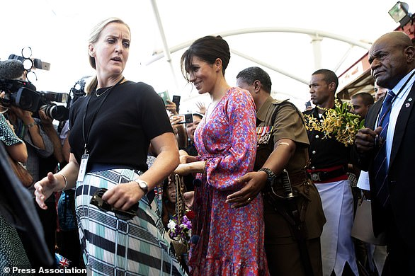 The Duchess of Sussex is escorted through a market in Suva, Fiji, during an official tour (Ian Vogler/PA)