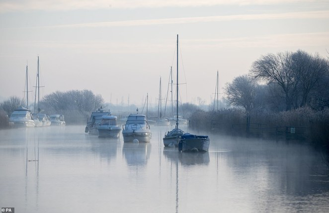 Boats lie moored along the River Frome in Wareham, Dorset, on a foggy morning for many parts of southern England