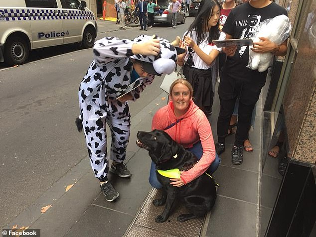 Casey Hyde and her guide dog Bridget share a cuddle on the street