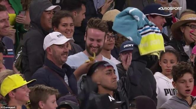 What the...A fan is left stunned when he realises he has caught an old banana peel thrown by tennis bad boyNick Kyrgios