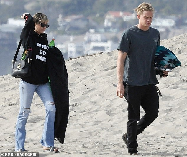 Chilly: Despite the breezy and overcast day, the celebrity couple still wanted to relax on the beach