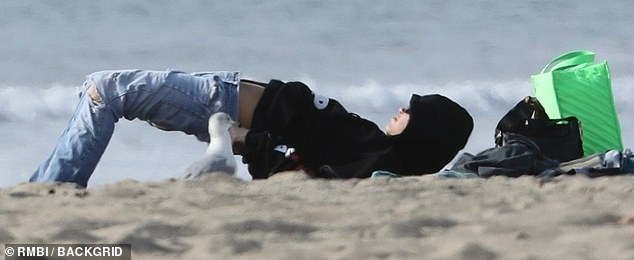 Voyeur: Miley shimmied back into her jeans while a seagull watched feet away