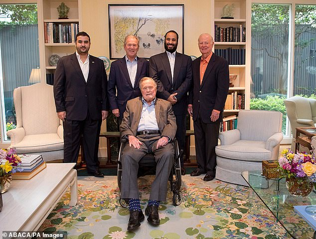 George W Bush (centre left), his father George Bush Sr (front) and formerSecretary of State James Baker (top right) meet with Bin Salman during his US trip