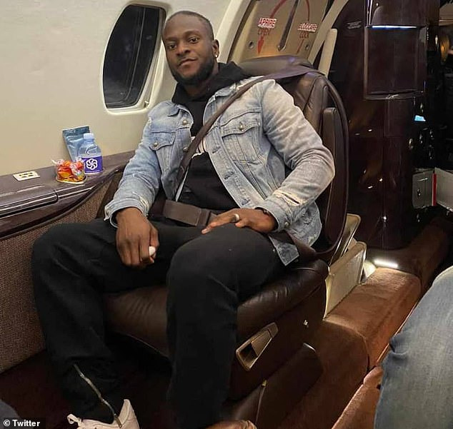Moses poses for a photograph as he makes his way to Italy on a private jet on Monday night