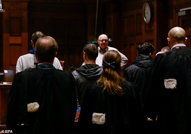 A back view of the bench of the accused in the trial of five men - three Belgians, a Dutchman and a British - accused of being at the heart of a paedophile network in Dendermonde, Belgium