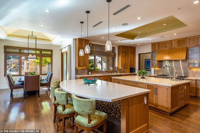 Within the expansive mansion is a large kitchen complete with a full cooking range, middle kitchen bench, side-bar table and full dining table to cater to any kind of social gathering