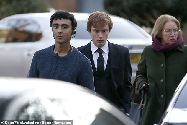 Transformation: The scenes filmed on Friday appeared to be of a somber nature, with a suited Freddie joined by other cast members