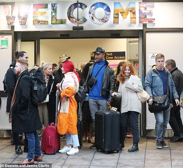 Happy days:The Strictly Come Dancing cast and crew were left stranded at Manchester Airport in the midst of the UK tour on Thursday